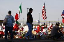 The Mexican and U.S. flags fly at a makeshift memorial honoring victims outside Walmart, near the scene of a mass shooting which left at least 22 people dead, on August 7, 2019, in El Paso, Texas. Photo by Mario Tama/Getty Images