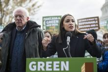 Rep. Alexandria Ocasio-Cortez, D-N.Y. and Sen. Bernie Sanders, D-Vt., along with affordable housing advocates and climate change activists announce the introduction of public housing legislation as part of the Green New Deal outside the Capitol on Nov. 14, 2019. Bill Clark / CQ-Roll Call, Inc via Getty Images