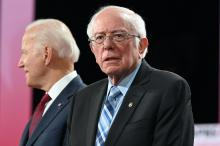 Democratic presidential hopefuls former Vice President Joe Biden and Vermont Senator Bernie Sanders arrive on stage ahead of the sixth Democratic primary debate of the 2020 presidential campaign season co-hosted by PBS NewsHour & Politico at Loyola Marymount University in Los Angeles, California on December 19, 2019. Photo: Robyn Beck/Getty Images