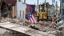 Debris is removed from a main road in Guanica, Puerto Rico, after the quakes. RICARDO ARDUENGO / AFP via Getty Images