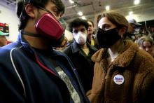 Concerned about the spread of COVID-19 in large gatherings, students from the University of North Carolina School of the Arts wear respiratory masks as they wait for Democratic presidential candidate Sen. Bernie Sanders (I-VT) to speak to supporters during a rally and march to early vote on February 27, 2020 at Winston-Salem State University in Winston-Salem, North Carolina. Photo: Brian Blanco/Getty Images.
