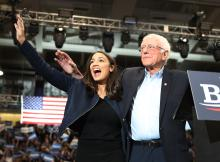 U.S. Rep. Alexandria Ocasio-Cortez (D-N.Y) and Democratic presidential candidate Sen. Bernie Sanders (I-VT) stand together during his campaign event at the Whittemore Center Arena on February 10, 2020 in Durham, New Hampshire. Photo: Joe Raedle/Getty Images.