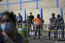 People line up to have a COVID-19 test done at a mobile laboratory in Guatemala City on Jan.27, 2021. Photo: John Ordonez/AFP via Getty Images.