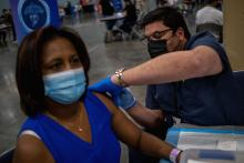 Puerto Rico's Health Department Secretary, Dr. Carlos Mellado (L) inoculates a woman with the Johnson and Johnson Covid-19 vaccine at the Puerto Rico Convention Center in San Juan, Puerto Rico on March 31, 2021. Photo:Ricardo Arduengo/AFP via Getty Images