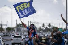 People protest against the public-private partnership between the public instrumentality and LUMA Energy in San Juan, Puerto Rico, on June 1, 2021. The private company will take over PREPA's energy transmission and distribution for the next 15 years. Photo: Alejandro Granadillo/NurPhoto via Getty Images