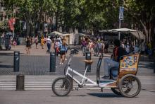A pedicab waits for customers on Las Ramblas. With 50% of the citizens of Catalonia vaccinated with the first dose, tourism begins to be seen in the streets of Barcelona, especially in the historic center of the city. Photo: Paco Freire/SOPA Images/LightRocket via Getty Images
