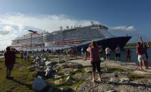 People come out to watch the new Carnival Cruise Line ship Mardi Gras as it departs on its maiden voyage, a seven-day cruise to the Caribbean from Port Canaveral, Florida on July 31, 2021. Photo:Paul Hennessy/Anadolu Agency via Getty Images.