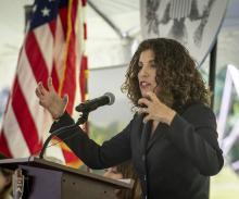 Myrna Perez, Director of the Brennan Center's Voting Rights and Elections Program, speaking to the packed house of immigrants, family, friends and officials during the annual naturalization ceremony in celebration of Constitution and Citizenship Day at the Sagamore Hill National Historic Site in Oyster Bay, New York on September 17, 2019. Photo: John Conrad Williams Jr./Newsday RM via Getty Images