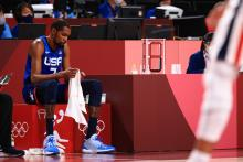Kevin Durant #7 of Team United States sits on the bench in disappointment as time winds down in the United States' loss to France in the Men's Preliminary Round Group B game on day two of the Tokyo 2020 Olympic Games at Saitama Super Arena on July 25, 2021 in Saitama, Japan. Photo:Mike Ehrmann/Getty Images