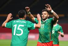 Alexis Vega #11 of Team Mexico celebrates with Uriel Antuna #15 after scoring their side's first goal during the Men's First Round Group A match between South Africa and Mexico on day five of the Tokyo 2020 Olympic Games at Sapporo Dome on July 28, 2021 in Sapporo, Hokkaido, Japan. Photo: Masashi Hara/Getty Images.