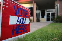 A bilingual sign stands outside a polling center at public library ahead of local elections on April 28, 2013 in Austin, Texas. Early voting was due to begin Monday ahead of May 11 statewide county elections. The Democratic and Republican parties are vying for the Latino vote nationwide following President Obama's landslide victory among Hispanic voters in the 2012 election. Photo: John Moore/Getty Images.