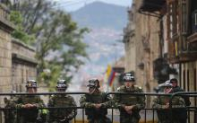 BOGOTA, COLOMBIA - OCTOBER 02: Presidential Gaurd soldiers keep watch during the referendum on a peace accord to end the 52-year-old guerrilla war between the FARC and the state on October 2, 2016 in Bogota, Colombia. The guerrilla war is the longest-running armed conflict in the Americas and has left 220,000 dead. The plan called for a disarmament and re-integration of most of the estimated 7,000 FARC fighters. (Photo by Mario Tama/Getty Images)