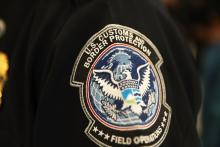 MIAMI, FL - FEBRUARY 27: A patch is seen on the sleeve of a U.S. Customs and Border Protection officer as he uses facial recognition technology in his booth at Miami International Airport to screen a traveler entering the United States on February 27, 2018 in Miami, Florida. (Photo by Joe Raedle/Getty Images)