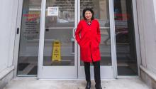Dr. Bonilla-Santiago in front of a building on the LEAP Academy campus that bears her name in her honor. Photo: Samantha Laub / AL DÍANews
