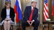 In the photo: the interpreter Marina Gross, takes note when the president of the United States, Donald Trump, speaks with Russian President Vladimir Putin at the beginning of their personal meeting at the Presidential Palace in Helsinki, Finland. Source: https://www.voanews.com/