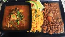 Guisado with rice and beans. Photo: Eli Siegel