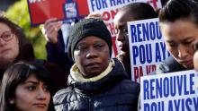 People gather in New York to protest the decision of the Trump administration to end the so-called temporary protection status for immigrants from Haiti. (Mark Lennihan / Associated Press)