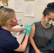 Ivonne Garcia, Philadelphia resident and community activist recieving her COVID-19 vaccine.
