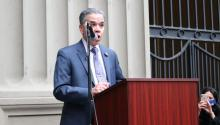 Carlos Vega outside the DA's office on Dec. 16, 2021, announcing his run for office. Photo: Nigel Thompson/AL DÍA News.