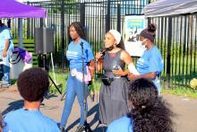 Community youth leaders with We Can stand with Nia Eubanks-Dixon (center), founder of Creative Praxis. Photo: Nigel Thompson/ AL DÍA news.