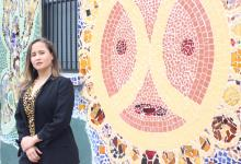 Executive director Siria Rivera stands in front of mural that covers the outside of Providence Center in Fairhill, Philadelphia. Photo: Jensen Toussaint/AL DÍA News.