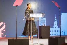 Zoe Saldana giving a speech at the USHCC National Convention about her journey towards starting her own business, BESE.