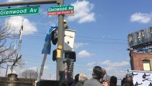 Taking the wraps off of street sign honoring legendary boxing champion Joe Frazier. Photo LBW