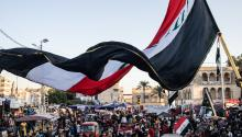 BAGHDAD, IRAQ - NOVEMBER 21: A flag waves over Tahrir Square on November 21, 2019 in Baghdad, Iraq. Thousands of demonstrators have occupied Baghdad's center Tahrir Square since October 1, calling for government and policy reform. (Photo by Erin Trieb/Getty Images)