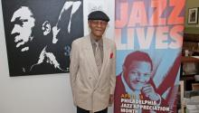 McCoy Tyner, four-time Grammy Award winner and 2015 city honoree to kick off Philadelphia Jazz Appreciation Month, posed with the current jazz campaign posters featuring his likeness. Photo: Bill Z. Foster Photography