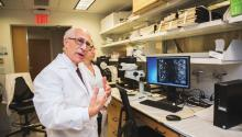 In his laboratory, Dr. Jose Russo explains how quickly cancer cells can develop. Photo: Sam Laub / AL DÍA News