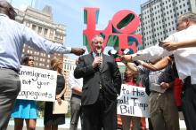 """Beneath the LOVE Park sculpture, Democratic mayoral nominee Jim Kenney took a stand Thursday against the """"Donald Trump"""" Bill. Photo: Samantha Madera/AL DÍA News"""