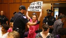 A woman initiates a protest while the conservative Brett Kavanaugh, candidate of the president of the United States, Donald Trump, to become judge of the Supreme Court, prepares to testify at the beginning of the hearings held for confirmation, in the Hart Senate Office Building of Washington DC, September 4, 2018. EFE/TASOS KATOPODIS