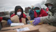 Staff and volunteers hold a drive for personal protective equipment to donate to hospitals in Chicago, where 70% of people who have died from COVID-19 are African American. Scott Olson/Getty Images