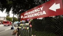 LOS ANGELES - MAY 17: An ambulance speeds past a sign pointing to the emergency entrance of Los Angeles County USC Medical Center in both English and Spanish May 17, 2004 in Los Angeles, California. (Photo by David McNew/Getty Images)