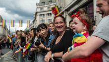 LONDON, ENGLAND - JUNE 25: Daisy Thwait, 1, watches the Pride parade with her father as the LGBT community celebrates Pride in London on June 25, 2016, in London, England. (Photo by Chris J Ratcliffe/Getty Images)​​​​​​​