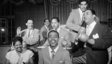 Machito appears in this photo on the right playing the maracas. His name was Francisco Raúl Gutiérrez Grillo. He impacted the New York musical world with Mario Bauzá, the musical director of his orchestra. Getty Images