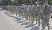 Army recruits march in this file photo. A lawsuit by several Army reservists says they have fulfilled requirements of a program for immigrant recruits but may be forced out and deported. (Sgt. Ken Scar/Army).