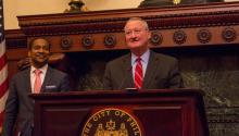Mayor Jim Kenney and City Solicitor Marcel Pratt speak at a press conference at City Hall on Wednesday about the federal ruling which found the Department of Justice's conditions used to deny the city of federal funding due to Philadelphia's welcoming policies for immigrants to be unconstitutional. Photo: Emily Neil / AL DÍA News