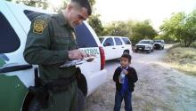 The Border Patrol and an immigrant child on the border. Photo: Jennifer Whitney / New York Times