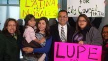 Candidate Manny Morales with (C) next to his wife Tisha (L), State Rep. Leslie Acosta and members of the coalition LUPE: Latinos United for Political Empowerment.