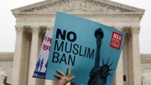 Protesters rally outside the U.S. Supreme Court in Washington, DC, U.S., April 25, 2018, while the court justices consider case regarding presidential powers as it weighs the legality of President Donald Trump's latest travel ban targeting people from Muslim-majority countries. REUTERS/Yuri Gripas