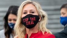 """Rep. Marjorie Taylor Greene sporting a face mask that reads """"Stop The Steal."""" Photo: Saul Loeb/Getty Images"""