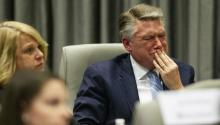 Mark Harris, the Republican candidate in North Carolina's Ninth Congressional District race, fights back tears at the conclusion of his son John Harris's testimony at a state board hearing on alleged election fraud. Travis Long/The News & Observer via AP