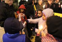 Angela Navarro's children, nieces and nephews light candles, one for each day Navarro's family spent in sanctuary.