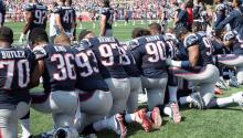 Stock photograph dated September 24, 2018 and released May 23, 2018, showing players of the New England Patriots prostrate on their knees as they listen to the national anthem of the United States before the start of a match against the Houston Texans at Gillette Stadium, in Foxboro, United States. EFE / John Cetrino