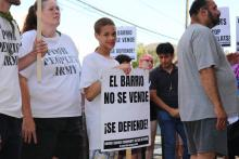 Residents were out in force at the corner of Howard and Norris streets on Aug. 8 against exclusive development in their community. Photo: Michelle Myers/AL DÍA News.