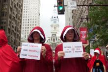 Protesters wearing costumes evoking the dystopian world of the popular Hulu series and novel, The Handmaid's Tale, stood outside the Union League in Philadelphia where Vice President Mike Pence was speaking on July 23.  Photo: Emily Neil / AL DÍA News
