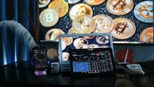 Screens with figures and bitcoin coins