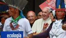 Pope Francis and indigenous leaders from the Amazonia in the Vatican Synod. Photos: Andreas Solaro/AFP via Getty Images.