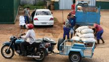 Motorcycles with side cars and trailers are used to haul goods away from the Trigal Market, a wholesale marketplace on the outskirts of the Havana, Cuba. Photo: Chip Somodevilla / Getty Images